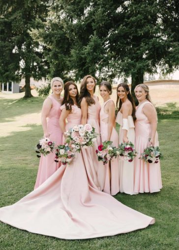 Bridal party holding bouquets of local summer flowers