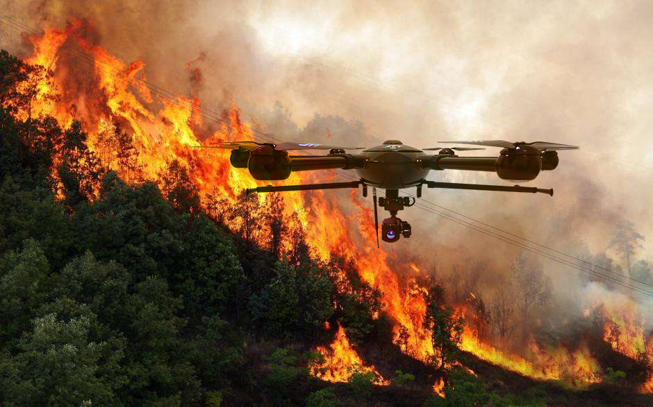 A drone hovering over a patch of fire
