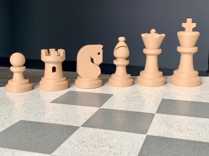 Image of 3D printed chess pieces based on Font Awesome icons.