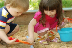 Children Playing in Sandbox