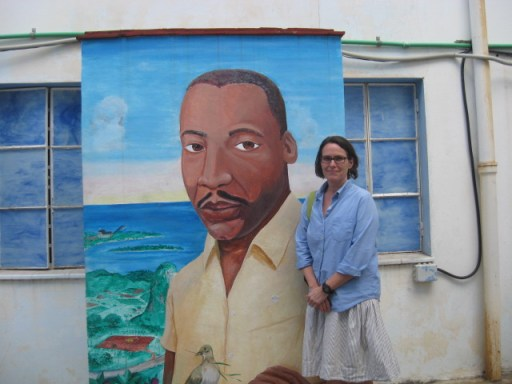 Veronica standing by mural of Dr. Martin Luther King Jr. in Cuba