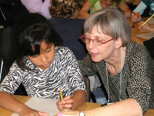 Author Susan Marie Swanson teaching at Friends School of Minnesota summer camp.