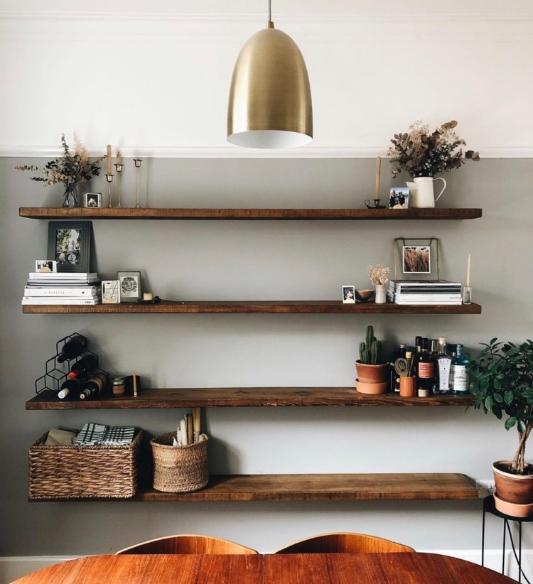 set of four large floating shelves in dining room