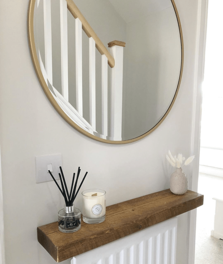 solid wooden shelf over a radiator in hall