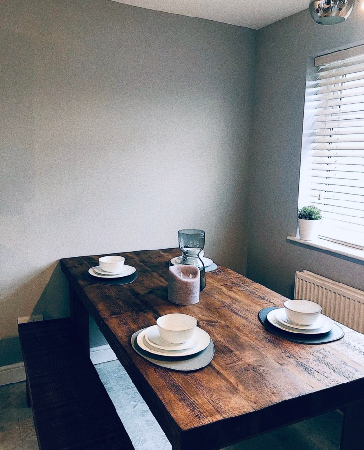 solid wood dining table and benches in grey dining room
