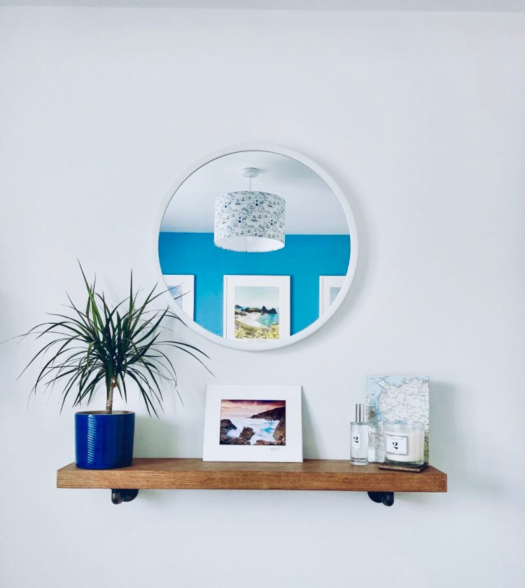 bracket shelf in beach inspired spare bedroom