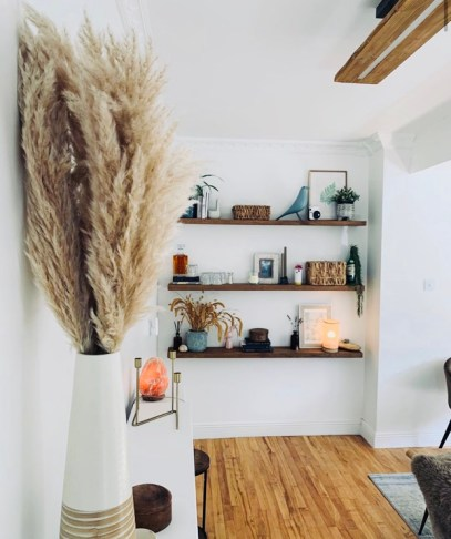 floating shelves in alcove in white room