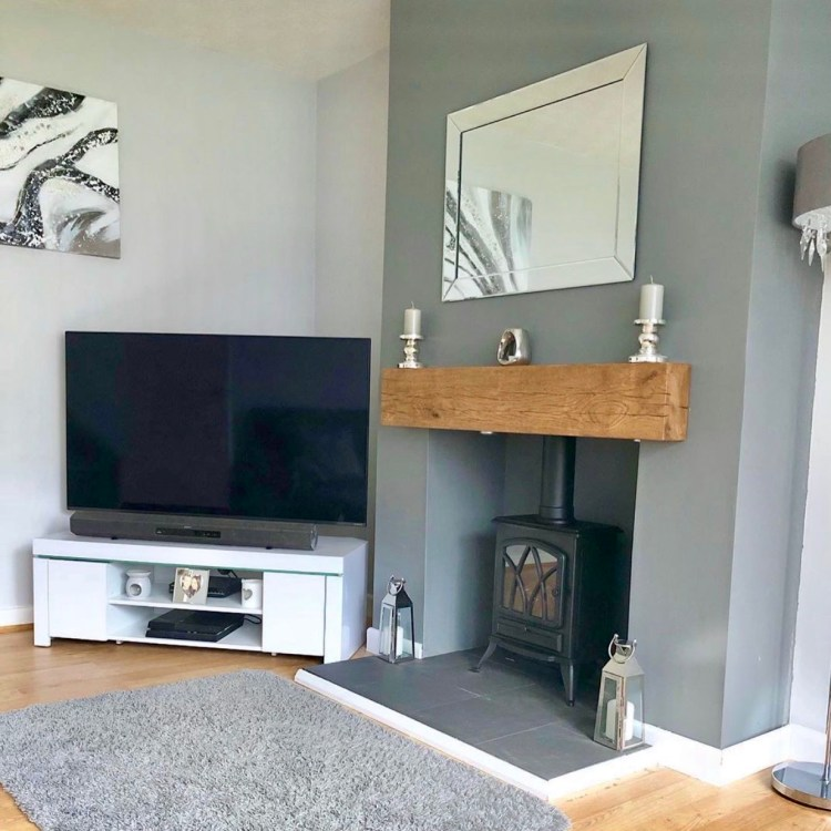 chunky oak mantel beam in grey living room