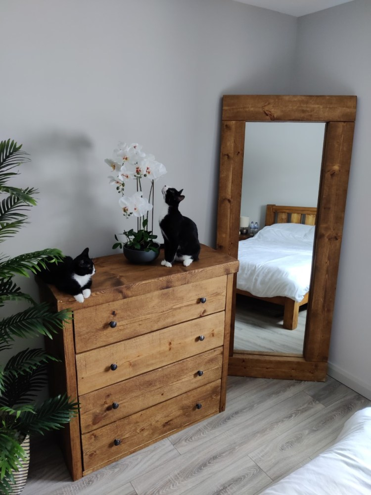 rustic bedroom furniture, chest of drawers and bed, with cats