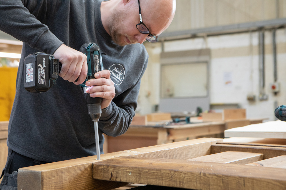 This image shows our assembly operative Chris drilling holes in the workshop.