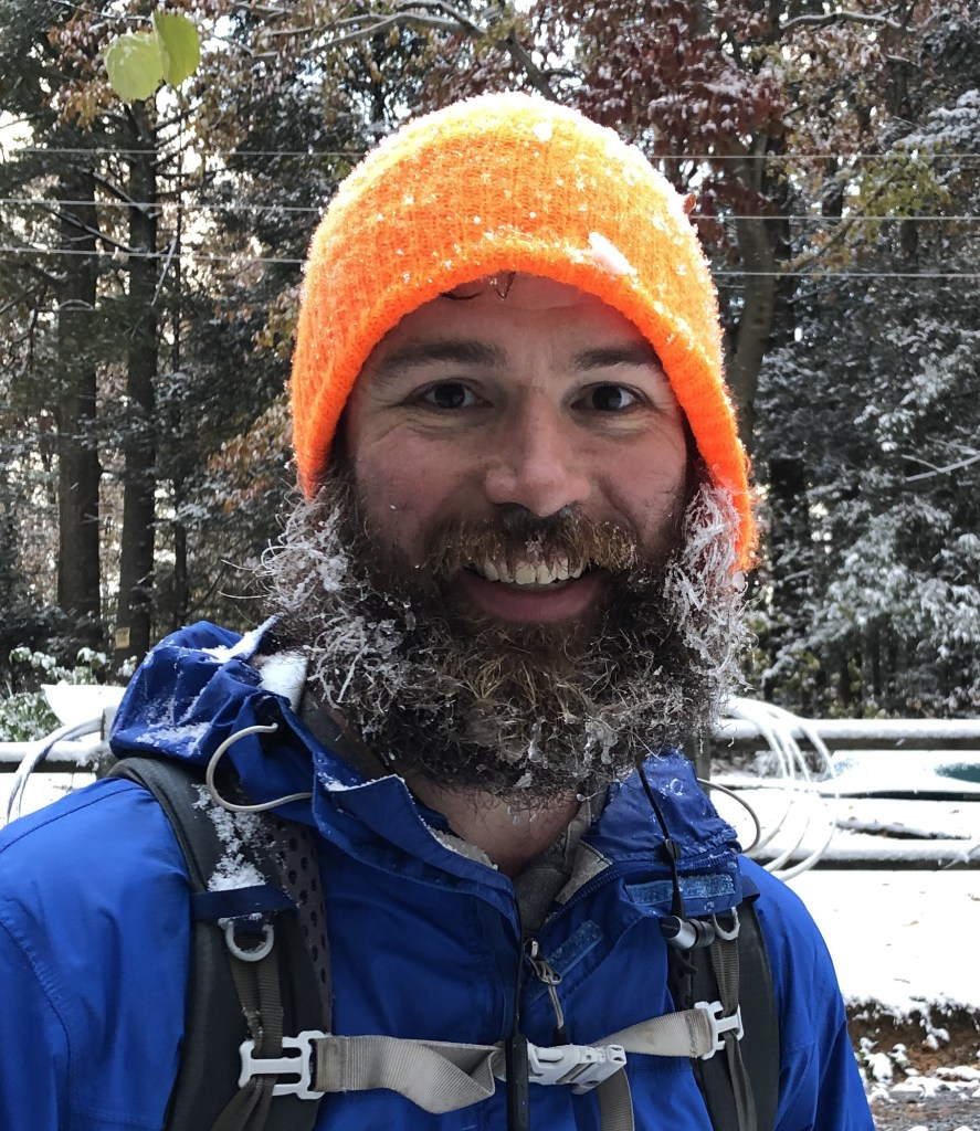 Out and Back podcast host Andrew Baldwin covered in snow on the Appalachian Trail.