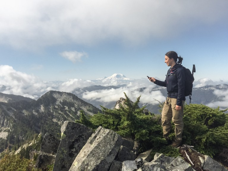 a hiker looking at her phone