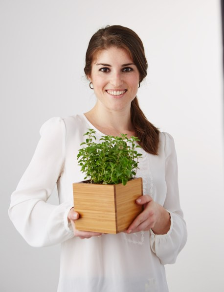 Woman Holding Herb showing gratitude