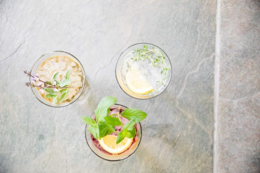 Drinks with fresh herb garnishes