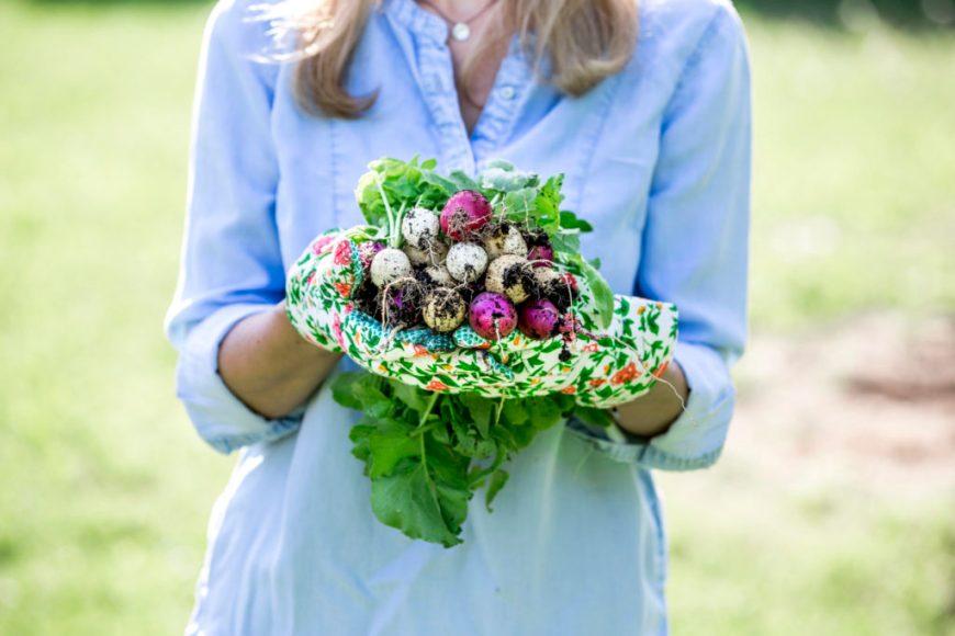 woman holding fall veggies