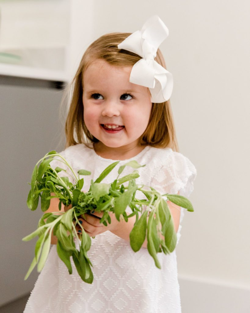 future foodie holding fresh harvest