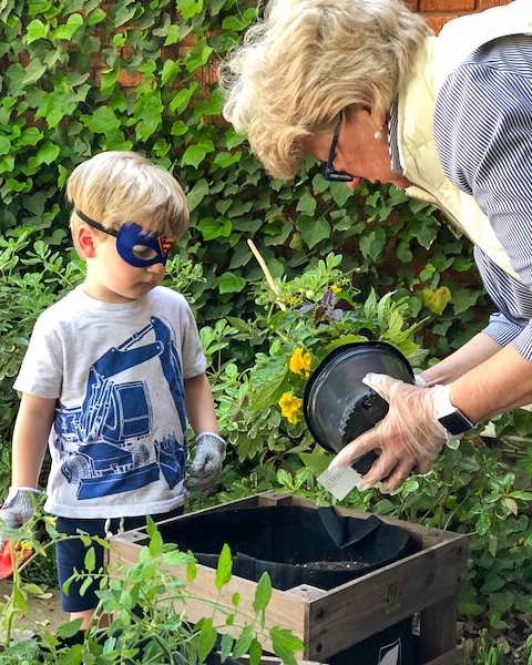Child planting a garden for earth day