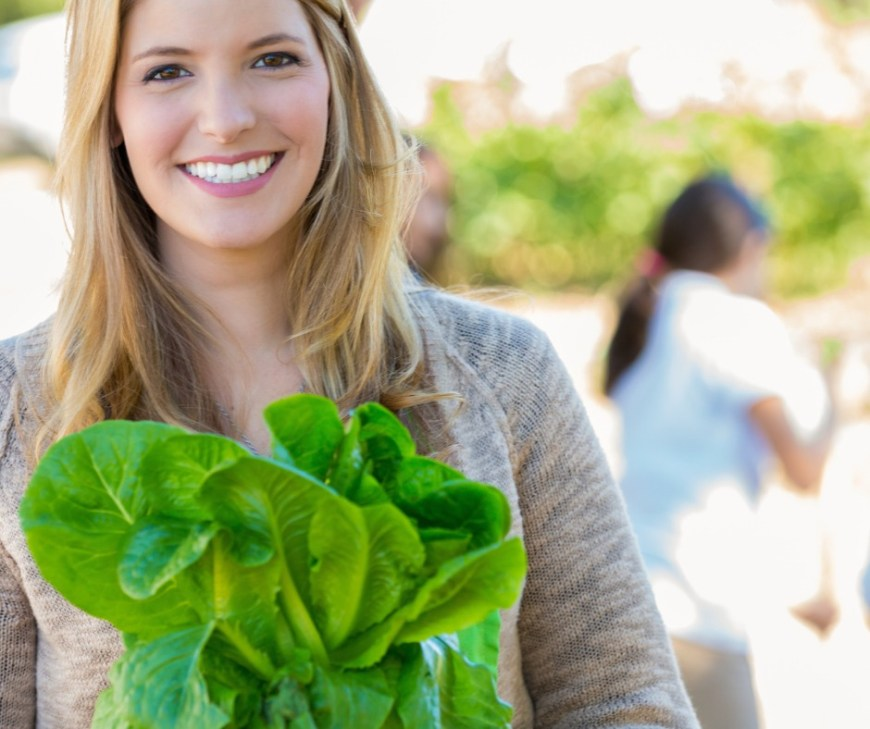 Woman Harvesting Fresh Veggies