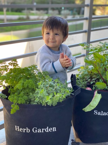 The Many Benefits of Gardening - Child with 2 Garden Kits