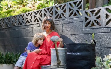 Woman with Son & Garden
