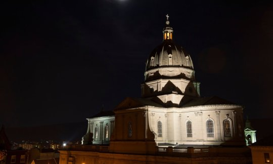 The cathedral church dome under a full moon in Altoona, Pennsylvania.