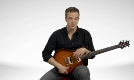 How To Hold An Electric Guitar – Guitar Lessons