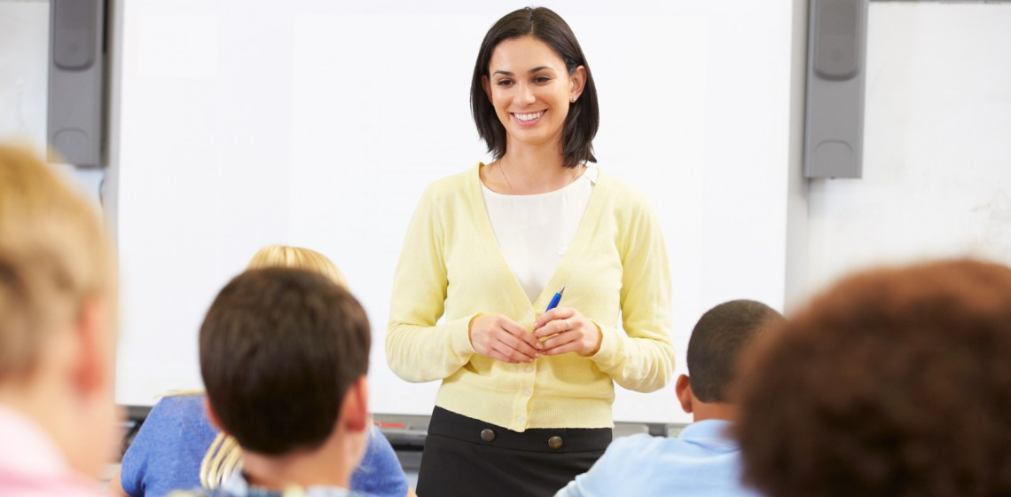 Teacher in front of classroom of students