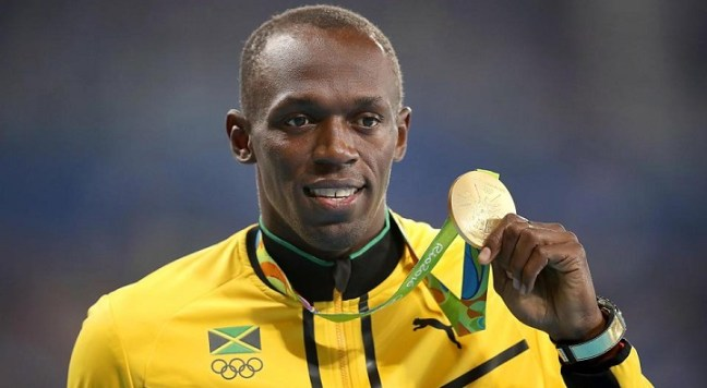 usain bolt with medal