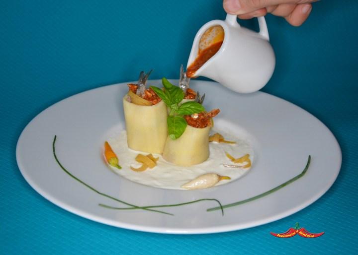 Paccheri, Acciughe, Colatura di alici di Cetara, Pomodorino del piennolo e zeste di Limone della costiera, su crema di ricotta