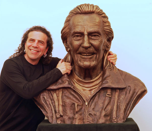 Sculptor Gino Cavicchioli with the bust of Gordon Lightfoot he created.