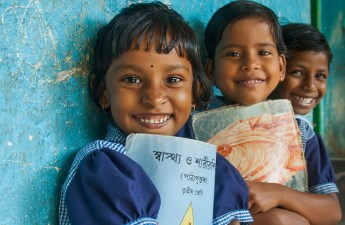 Children smiling with their books