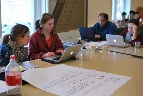 The first cohort hard at work finishing up their manuscripts.