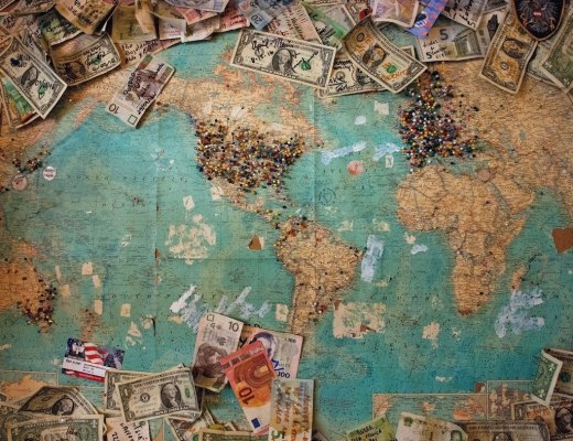 Lots of different currency on top of a map