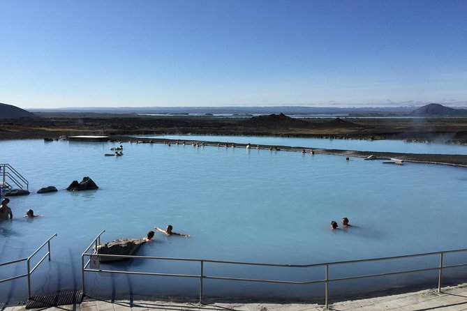 People swimming in the Mývatn Nature Baths.