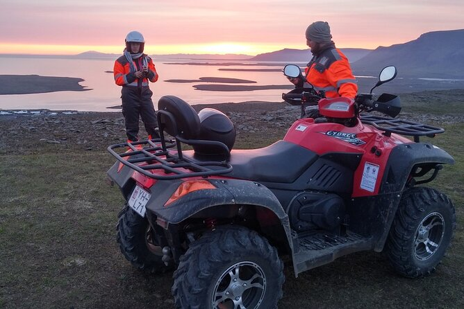 Two people on a sunset ATV tour near Reykjavik, Iceland