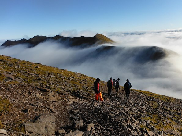 A group of people climbing Carrauntoohil, one of the best things to do in Killarney.