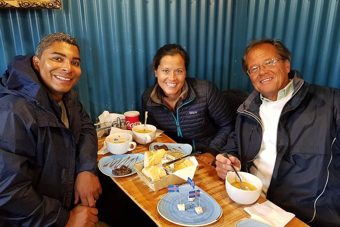 3 people eating fermented shark and other food during a Reykjavik food tour