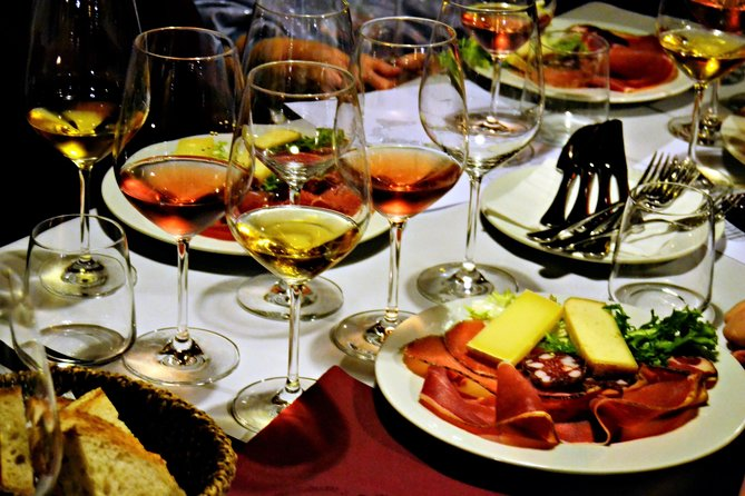 Table with wine, cheese, and meat samples during one of the best food tours in Rome.