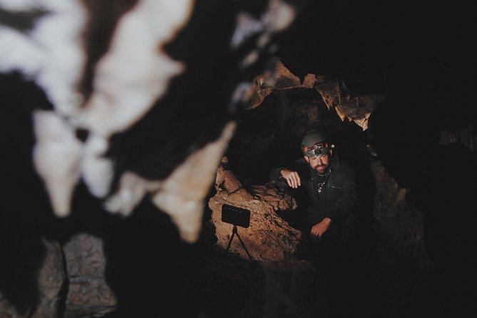 Person inside Spar Cave near Scotland's North Coast 500