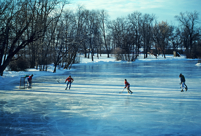 Ice Skating A game of hockey on an outdoor pond by Wisconsin Department of Natural Resources - CC BY 2.0 license