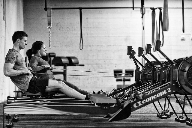 black and white image of 2 people doing crossfit