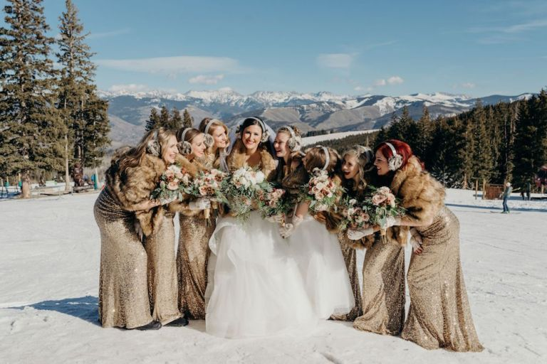 snowy-winter-wedding-ideas-bridesmaids-wraps