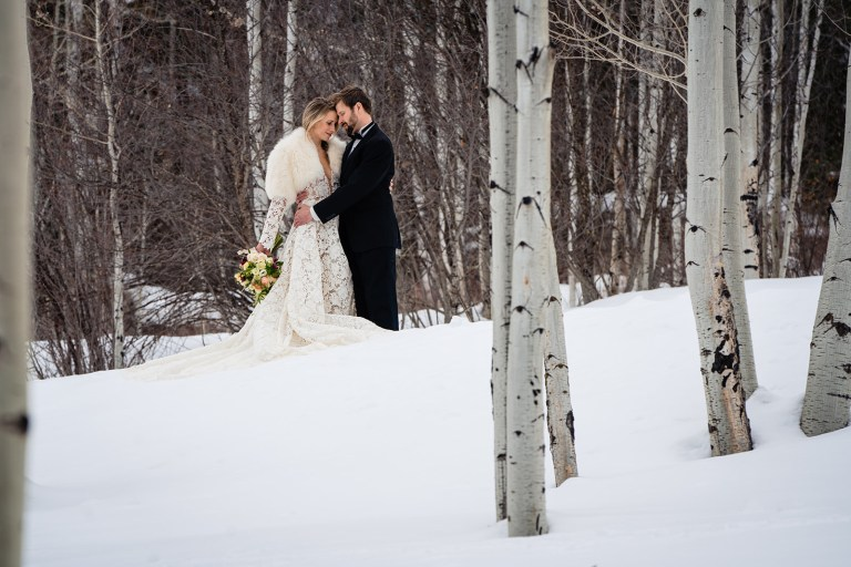 bride and groom in the snow