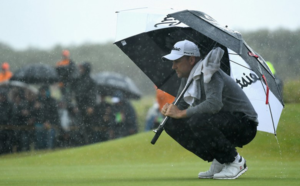 Ian Poulter Shelters From the Rain at the 2017 Open Championship, image: golfdigest.com