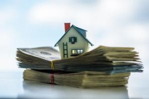 64389232 - house model on euro cash stack closeup