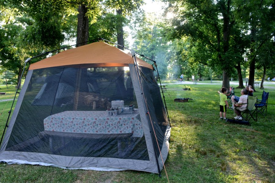 A family enjoys a summer evening at Winton Woods Campground.