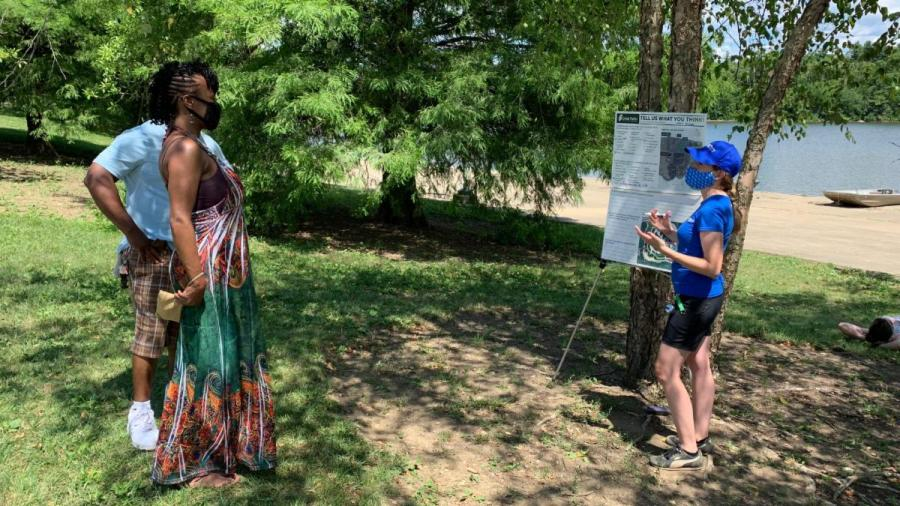 While remaining physically distant, a couple talks to a Great Parks employee during a public input session at Winton Woods Harbor.