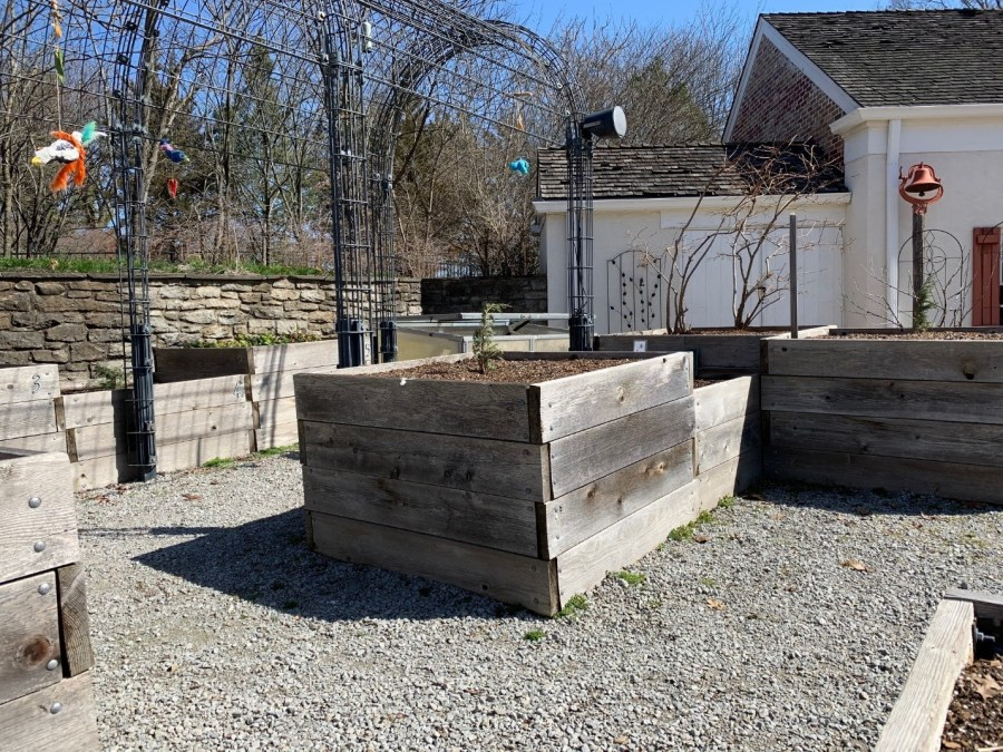 Raised garden beds sit outside the Highfield Discovery Garden Workshop.