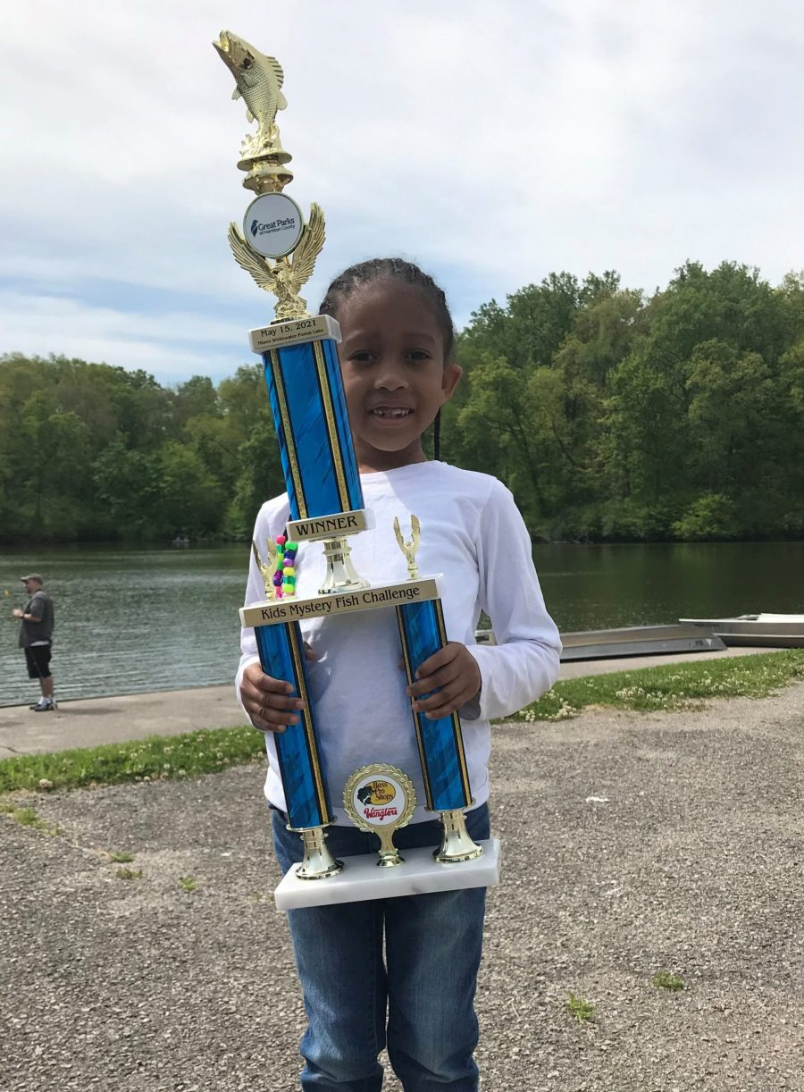 Mariah with her winning trophy at the Kids' Mystery Fish Challenge on May 15, 2021.