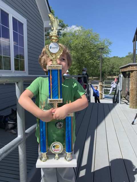 Finn with his winning trophy at the Kids' Mystery Fish Challenge on May 31, 2021.